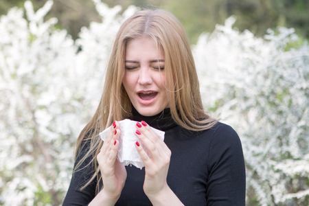 Woman reacts with pollen on hay fever