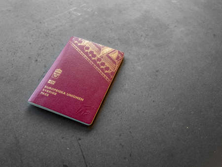 Swedish passport on dark background.