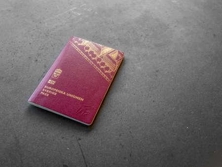Swedish passport on dark background. Zdjęcie Seryjne - 92210154