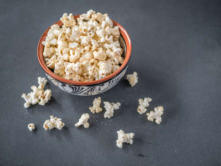 Popcorn in a bowl on a black background Stock Photo - 92208704