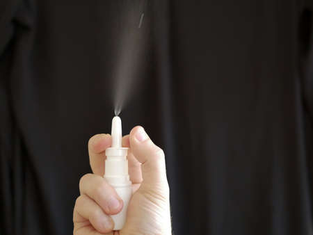 Nasal spray in a hand on black background Zdjęcie Seryjne - 92212206