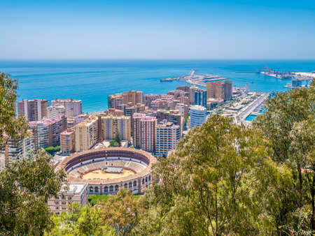View of Malaga and the Bullring in a summer day with  blue sky, Spain Editorial
