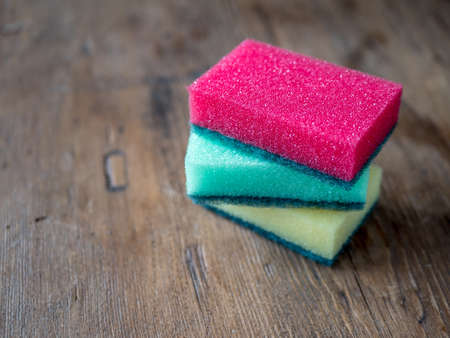Sponges for dishwashing wood background