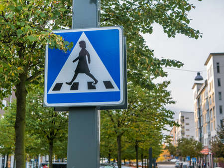 Crosswalk sign with women in Sweden. Stock Photo