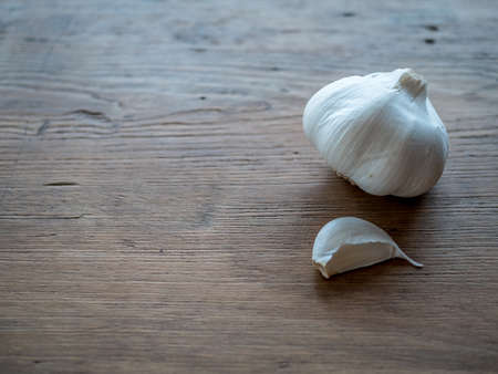 Garlic on wood table background. Stock Photo