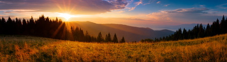 Beautiful panoramic view of the sunrise over the mountains in the morning