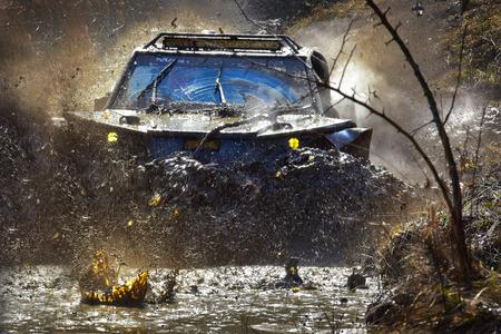 dirty car: Dirty blue car in mud crossing