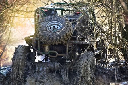dirty car: Dirty cross car in mud crossing Stock Photo