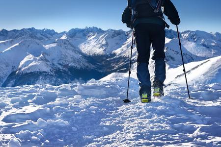crampon: Man hiking in winter Tatra mountain peaks Stock Photo