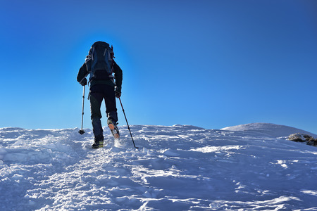 crampon: Man trekking on a snowy tatra mountain Stock Photo