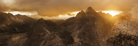 Panoramic view of high Tatra mountain peaks. Dramatic sky