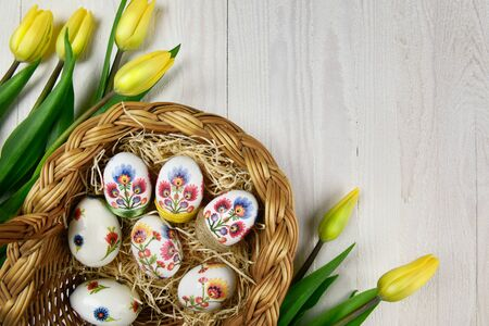 Easter eggs in hand made decoupage decoration with yellow tulips 版權商用圖片