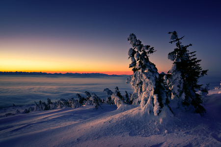 Winter sunrise at Babia mountain. View from Babia mountain to Tatra mountain. Poland