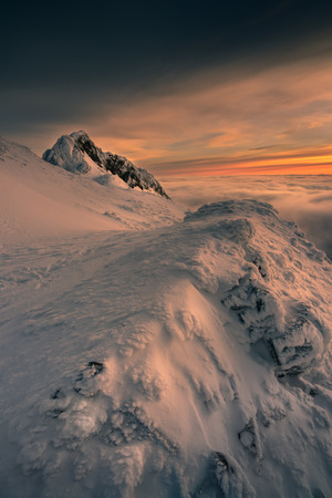 Cloudy morning in the Tatra mountains sunrise. Giewont peak