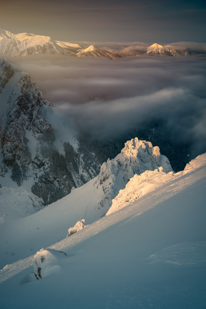 Clouds over the snow covered mountains. Tatra mountain 版權商用圖片