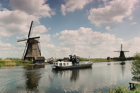 Ship between the windmills in Holland photo