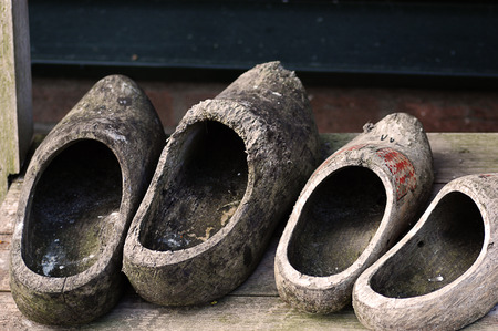 two pairs of Dutch clogs worn photo