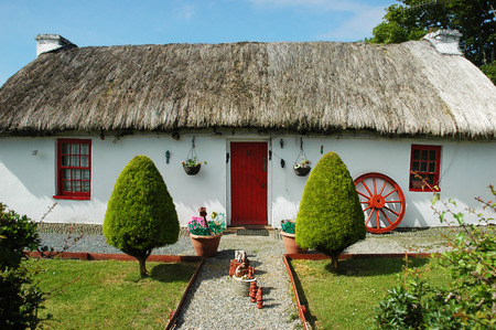 Typical Irish house with a thatched roof Editorial