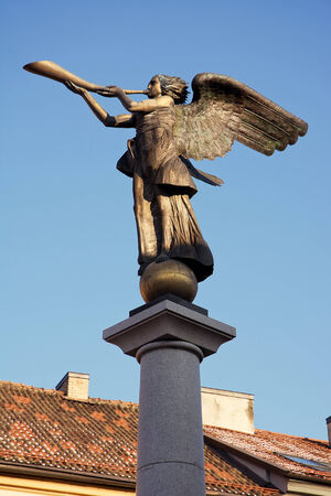 oldtown: the angel playing the horn in Vilnius, at the entrance of the district Uzupis