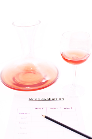 examination of the wine and notes the results photo