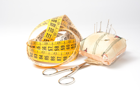 sartorial: Needles, tape measure and scissors: indispensable tools for the tailor Stock Photo