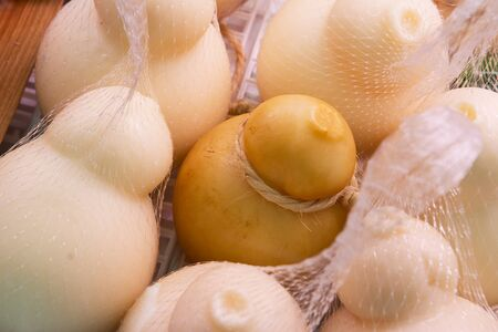 scamorza cheese: Typical apulia cheese in the market