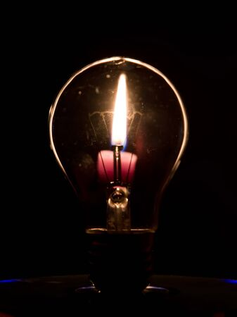 Lightbulb and candle flame