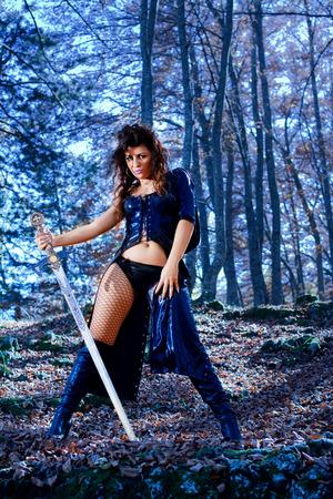 Woman with fantasy sexy dress and sword Foto de archivo