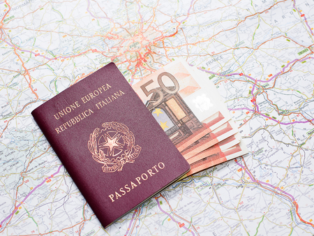 holiday budget: Passport, money and map before the travel
