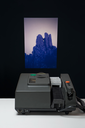 slideshow: old slide projector that projects on the wall Stock Photo