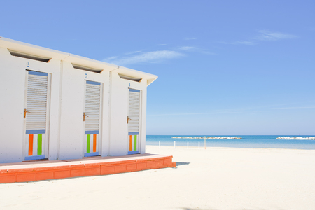 Cabins on the Adriatic beach and sea in the background Stock Photo