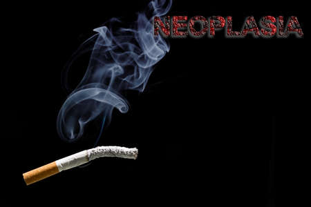 carcinogen: Burned cigarette and text neoplasia Stock Photo