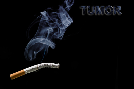 carcinogen: Burned cigarette and text tumor