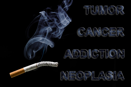 tumor: Burned cigarette and text Cancer, Tumor, addiction and neoplasia