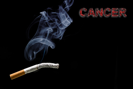 carcinogen: Burned cigarette and text Cancer