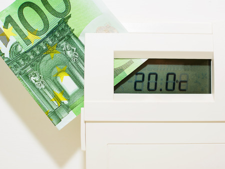 expensive: Concept thermostat and banknote for heating expensive