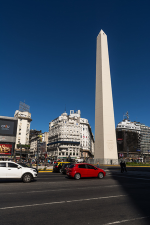 Buenos Aires, Argentina - October 29, 2016: Obelisk in the center of Buenos Aires in a sunny day of spring and tourist in the background Editorial