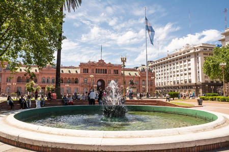 evita: Buenos Aires, Argentina - October 30, 2016: Casa Rosada in the Plaza de Mayo in Buenos aires with tourist in a sunny day.