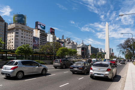obelisc: Buenos Aires, Argentina - October 30, 2016: Obelisk and Avenida 9 de Julio in Buenos Aires with traffic car in a sunny day
