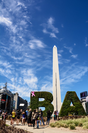 Buenos Aires, Argentina - October 30, 2016: Obelisk and tourist in the center of Buenos Aires in a sunny day of spring