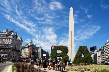 obelisc: Buenos Aires, Argentina - October 30, 2016: Obelisk and tourist in the center of Buenos Aires in a sunny day of spring