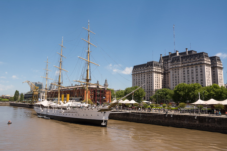 sarmiento: Frigate Sarmiento in the Rio de la Plata and Kirchner palace in the background (Buenos Aires, Argentina) Editorial