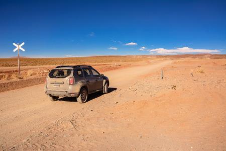 plateau: San Antonio De Los Cobres, Argentina - November 2, 2016: Car Renault Duster on Ruta ex 40 in Salta province from San Antonio Los Cobres to Salta