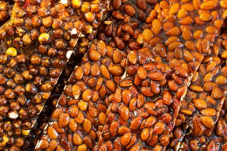 Heap of crunchy almond on tray Stock Photo