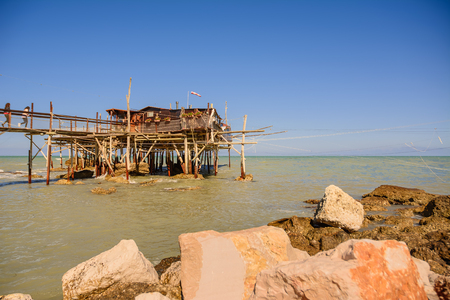Rocca San Giovanni - Italy: April 17, 2017: Traditional fishermans house in Abruzzo, called Trabocco with nobody. Editorial