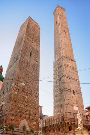 The tower of the Asinelli and Garisenda in Bologna (Italy) and the statue of San Petronio