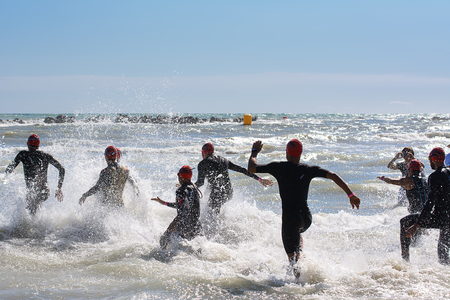rival: Pescara, Italy - June 18, 2017: Starting for the swimming test of the athletes of the Ironman 70.3 Pescara of June 18, 2017 Editorial