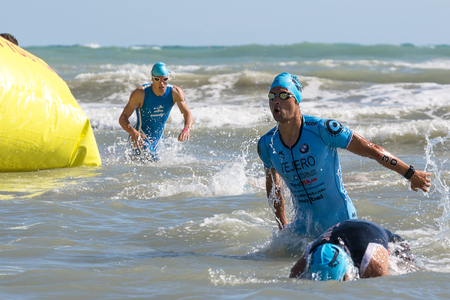 Pescara, Italy - June 18, 2017: Arrival of the first athletes at the end of the swimming test at Iroman 70.3 in Pescara