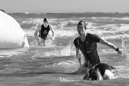 rival: Pescara, Italy - June 18, 2017: Arrival of the first athletes at the end of the swimming test at Iroman 70.3 in Pescara