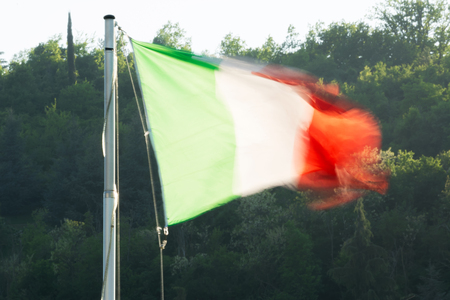 The Italian flag and green in backgroud